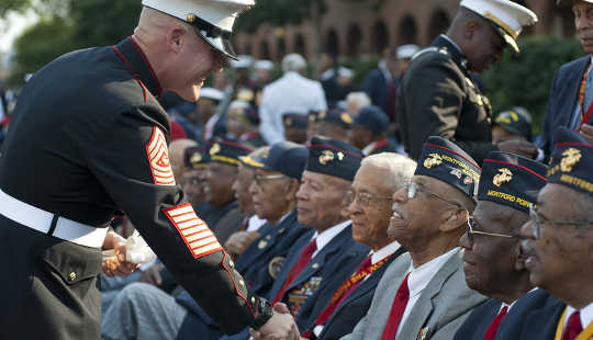 Gold medal service for black Marines who were treated unfairly in segregated boot camps. US Marine Corps