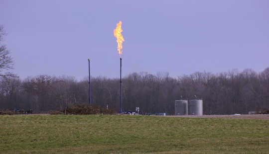 Flaring at a fracked well in northwestern Pennsylvania. One potential cause of health problems, such as asthma, in communities with fracking is higher rates of air pollution. wcn247/flickr, CC BY-NC