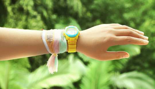 A bracelet made from fabric woven with special energy-harvesting strands that collect electricity from the sun and motion. (Credit: Georgia Tech)