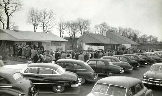 Buyers line up to purchase homes in Levittown, NY, the archetypal postwar suburb, built between 1947 and 1951. Until 1948, contracts for Levittown houses stated that the homes could not be owned or used by non-Caucasians. Mark Mathosian/Flickr, CC BY-NC-SA