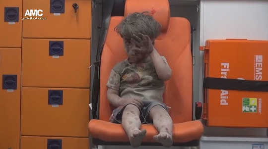 Five-year-old Omran Daqneesh in an ambulance after an alleged airstrike hit a house in Aleppo on August 17, 2016. ALEPPO MEDIA CENTER/@AleppoAMC