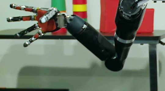 How Implants And A Robotic Arm Let A Paralyzed Man Regain Feeling