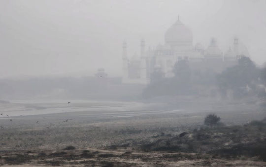 Smog obscures the Taj Mahal on Jan. 26, 2017.