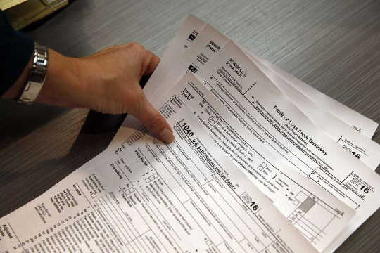 How Workers Are Being Taxed And Companies Are Skating