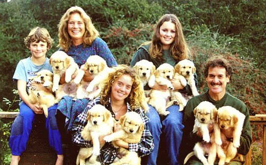 The Vissell family in 1997 with their first litter of Golden Retrievers, their family hobby.