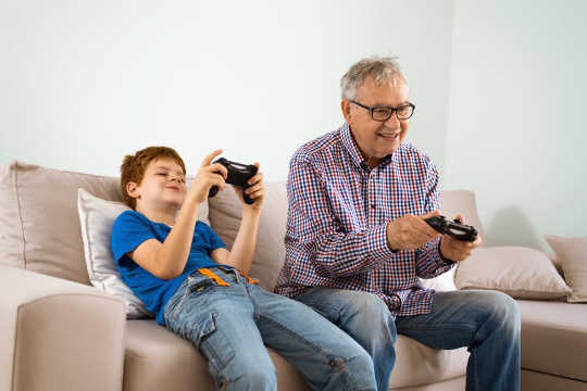 Research shows playing video games with family or friends can reduce the risk of neurodegenerative diseases such as Alzheimer's among adults.