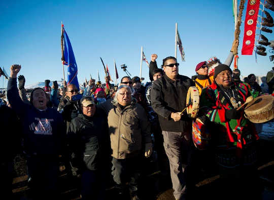 Protesters march at Oceti Sakowin camp, where people gathered to protest the Dakota Access oil pipeline (why covering the environment is one of the most dangerous beats in journalism)