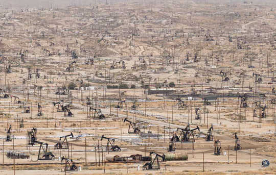 Pumpjacks dot the Kern River oil field outside Bakersfield, Calif.  (how fossil fuels are harmful in many ways and bad for your health)