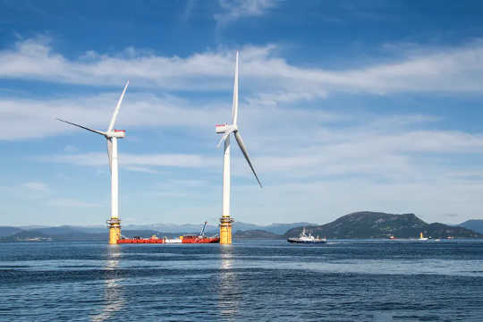 Two of the five turbines used in the world's first floating wind farm, Hywind Scotland.