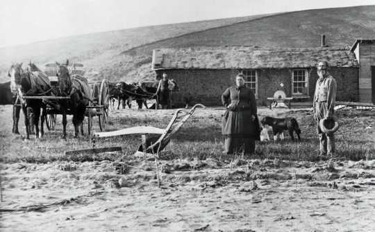 Settlers like these in Custer County, Nebraska, in 1870, got free or low-cost land from the government under the Homestead Act.