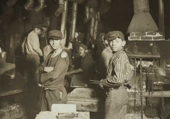 Midnight at the glassworks in Indiana, with children on the job. Child labour was among the practices outlawed by progressive governments in the early 1900s.
