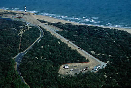 In 1999 the National Park Service moved the historic Cape Hatteras Lighthouse 2,900 feet inland (new site at lower right in photo) to protect it from shoreline erosion.