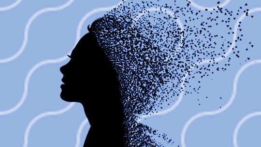 silhuetten av ett kvinnas huvud och det går sönder