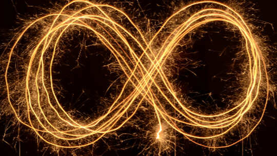 the infinity symbol made up of strands of light