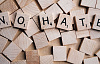 Scrabble letters that spell out: NO HATE