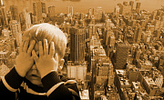 boy covering up his face as if afraid of the tall city landscape behind him