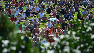 People take part in a mass meditation on the lawn of Parliament Hill in Ottawa in 2017.
